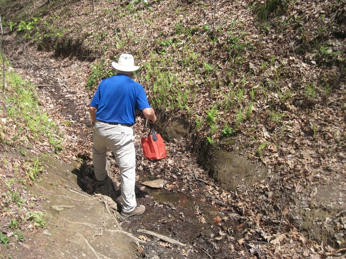 John headed up a stream for water