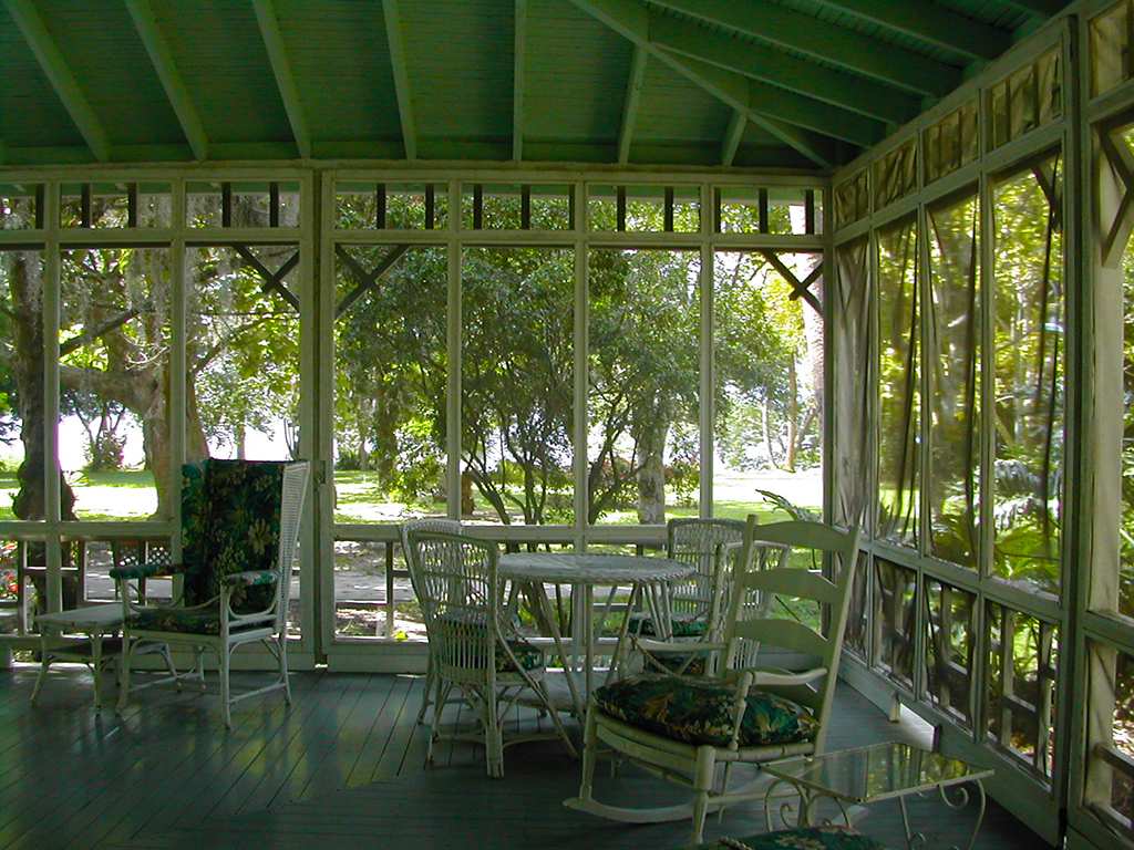 On the porch of Thomas Edison's winter home at Edison & Ford Winter Estates