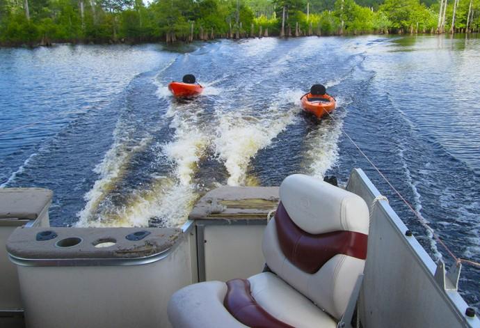 Towing the kayaks