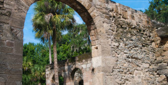 Peeking through an arch in the coquina walls