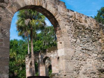 Peeking through an arch in the coquina walls