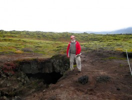 John at the entrance to the lava tube