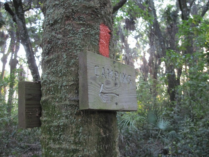 Sign in Lucky Hammock pointing to the campsite