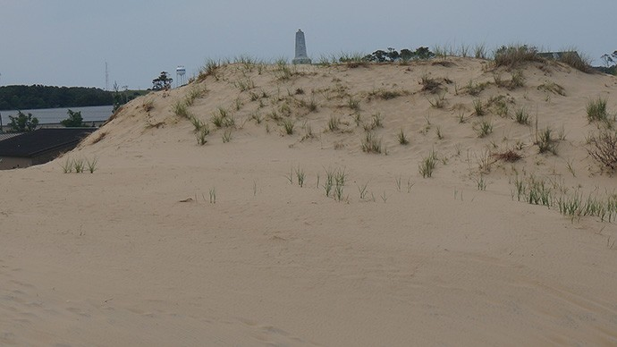The Wright memorial as seen from nearby dunes