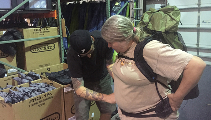 Matt Favero helps Sandy with a pack fitting