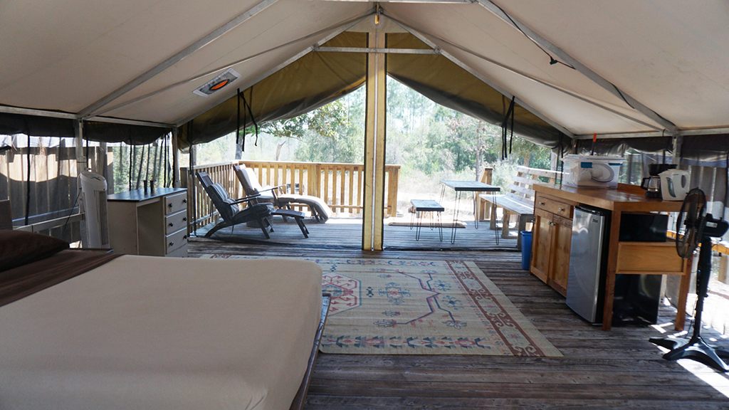 Inside a glamping tent at Coldwater Gardens