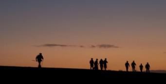 Hikers at dawn on the Big O Hike