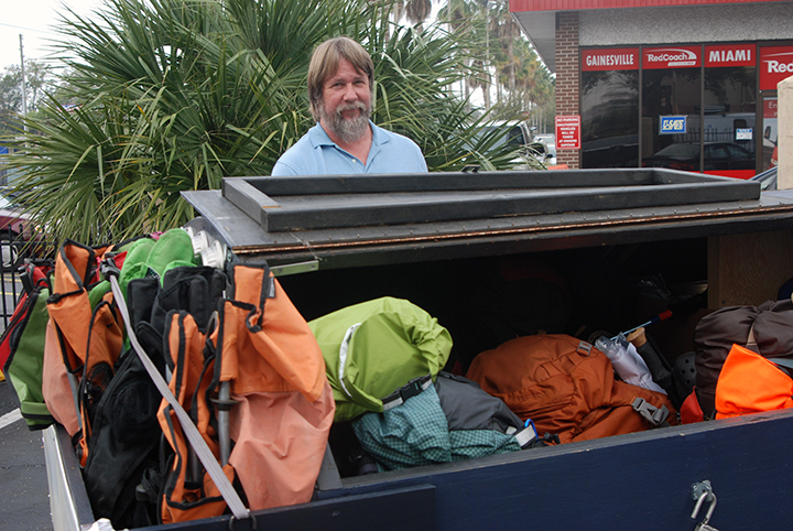 Chuck Norris and a trailer full of backpacks